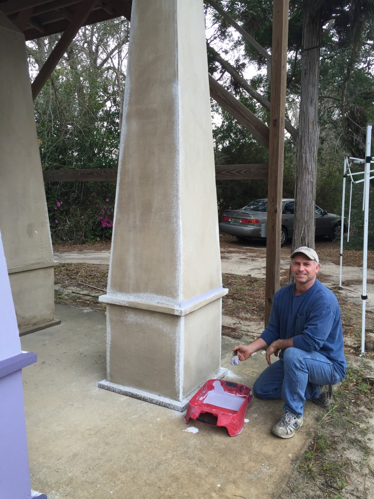 Bellingrath staff member Ralph Drury III works on the obelisks for the French-themed garden installation.