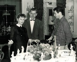 Fred Holder, left, accompanies Debbie Reynolds and Eddie Fisher during their visit to the Gardens in 1956.