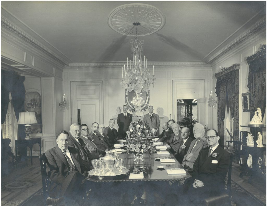 First National Bank Board of Directors meeting, Bellingrath Home Dining Room, Feb. 23, 1953, from left: Stephen B. Quigley, J. Linyer Bedsole, John M. Griser, Herbert Brown, Duncan C. Smith, Walter D. Bellingrath, H. Austill Pharr, Robert Bacon, Mark Lyons, Dr. Joe Mighell, G. Cabell Outlaw, Alfred F. Delchamps, John E. Toomey and Francis H. Inge.