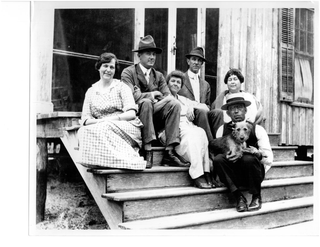 Walter and Bessie Bellingrath pose at Belle Camp with family members.